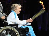 Former Paralympic archer Margaret Maughan lights the cauldron in August 2012