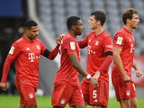 Bayern Munich players celebrate scoring their fifth goal against Eintracht Frankfurt on May 23, 2020
