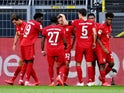 Bayern Munich players celebrate Joshua Kimmich's goal against Borussia Dortmund on May 26, 2020