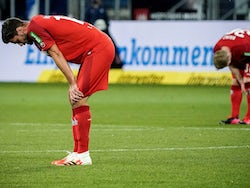 FC Koln players look dejected after their match against Hoffenheim on May 27, 2020