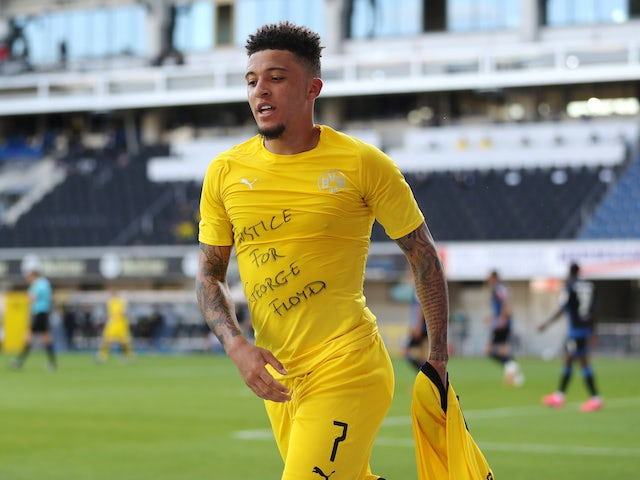 Borussia Dortmund winger Jadon Sancho celebrates scoring against Paderborn on May 31, 2020