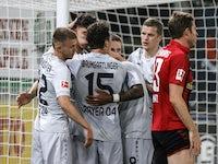 Bayer Leverkusen players celebrate Kai Havertz's goal against Freiburg on May 29, 2020