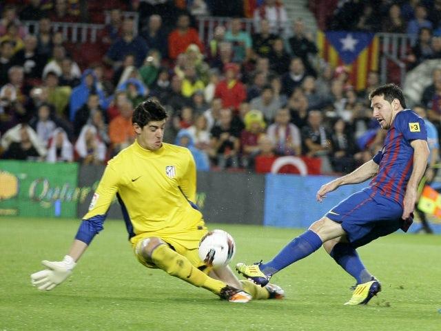 Barcelona's Lionel Messi scoring against Atletico Madrid in September 2011