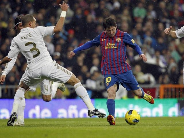 Barcelona's Lionel Messi scoring against Real Madrid in December 2011