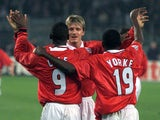 Manchester United trio David Beckham, Andy Cole and Dwight Yorke celebrate a goal against Juventus in April 1999