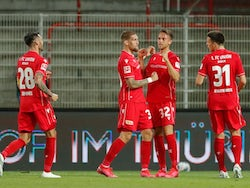Union Berlin players celebrate Marcus Ingvartsen's goal on May 27, 2020