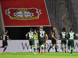 Wolfsburg players celebrate scoring against Bayer Leverkusen on May 26, 2020