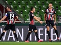 Eintracht Frankfurt players celebrate Stefan Ilsanker's goal against Werder Bremen on June 3, 2020