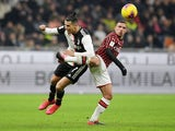Juventus' Cristiano Ronaldo in action with AC Milan's Ismael Bennacer in February 2020