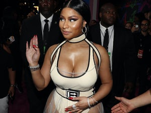 "Nicki Minaj tells fans to ""be angry"" over George Floyd death"