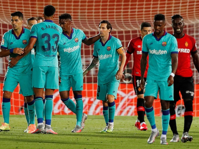 Barcelona players celebrate scoring against Mallorca on June 14, 2020