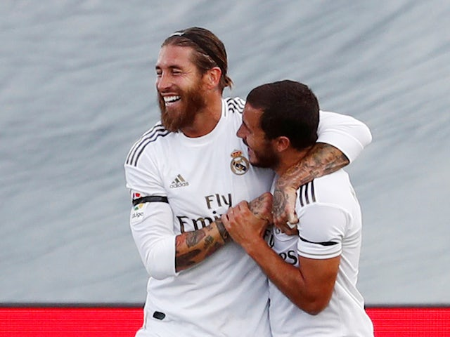 Real Madrid captain Sergio Ramos celebrates with Eden Hazard after scoring on June 14, 2020