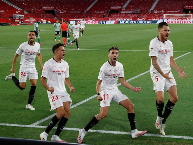Sevilla's Lucas Ocampos celebrates opening the scoring against Real Betis on June 11, 2020