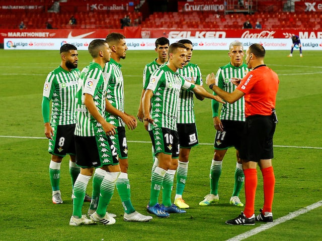 Real Betis players complain to the referee during their match against Sevilla on June 11, 2020
