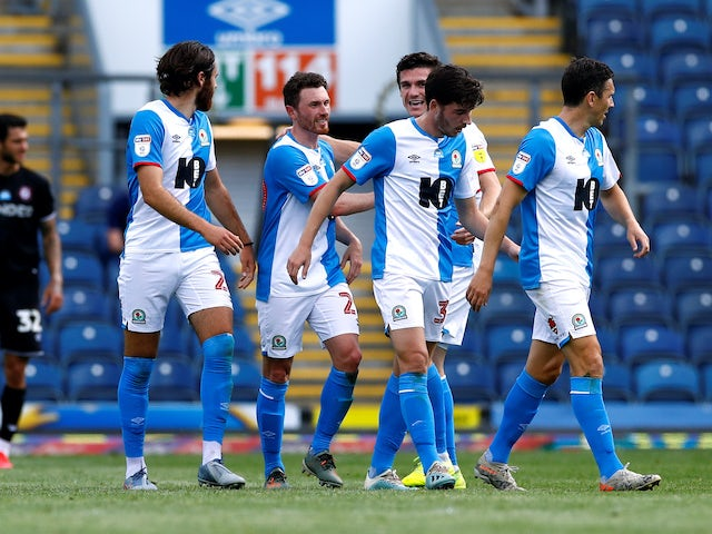 Corry Evans celebrates with Blackburn teammates after scoring against Bristol City on June 20, 2020