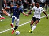 Said Benrahma of Brentford and Fulham's Michael Hector in action on June 20, 2020