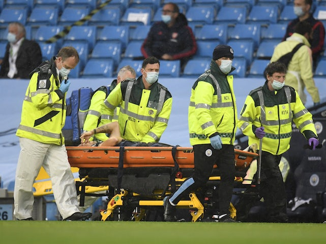 Arsenal midfielder Granit Xhaka is stretchered off against Manchester City on June 17, 2020