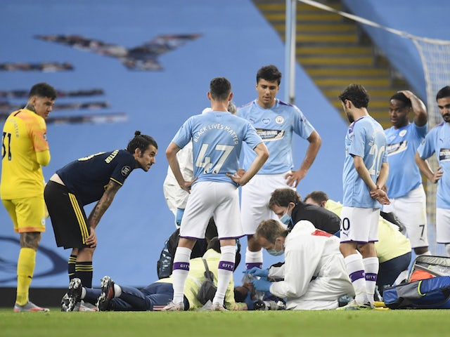 Manchester City defender Eric Garcia receives treatment against Arsenal on June 17, 2020