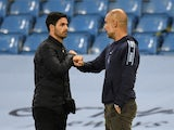 Manchester City manager Pep Guardiola and Arsenal boss Mikel Arteta pictured together on June 17, 2020