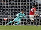 Manchester United midfielder Bruno Fernandes scores a penalty against Tottenham Hotspur on June 19, 2020