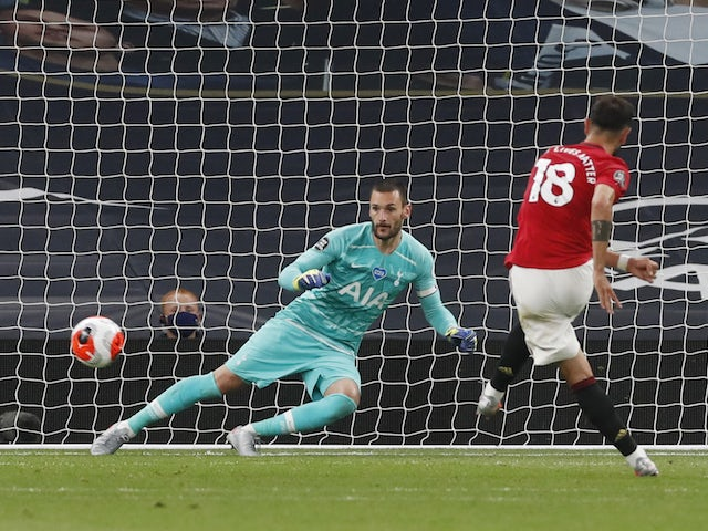 Manchester United midfielder Bruno Fernandes scores a penalty against Tottenham Hotspur on June 19, 2020