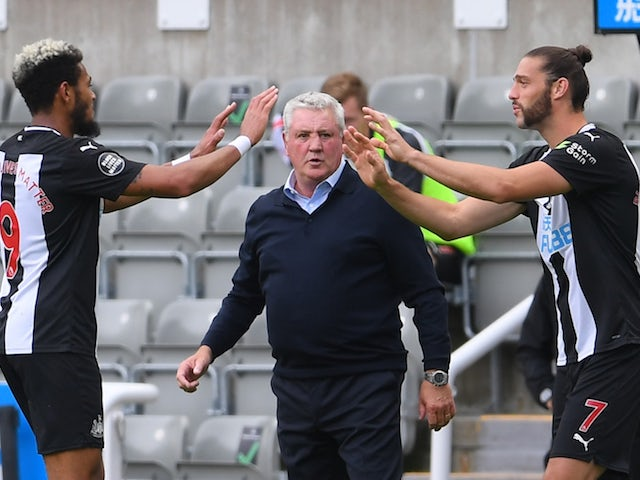 Newcastle United manager Steve Bruce watches on as Andy Carroll comes on for Joelinton on June 24, 2020