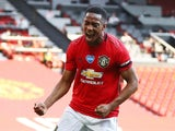Manchester United forward Anthony Martial celebrates scoring his hat-trick against Sheffield United on June 24, 2020
