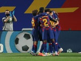 Barcelona players celebrate Ivan Rakitic's goal against Athletic Bilbao on June 23, 3030