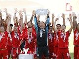 Bayern Munich goalkeeper Manuel Neuer lifts the Bundesliga trophy on June 27, 2020