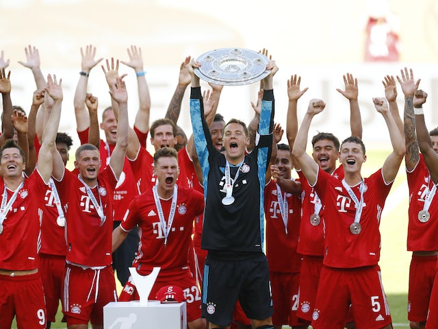 Bayern Munich goalkeeper Manuel Neuer lifts the Bundesliga trophy on June 27, 2020