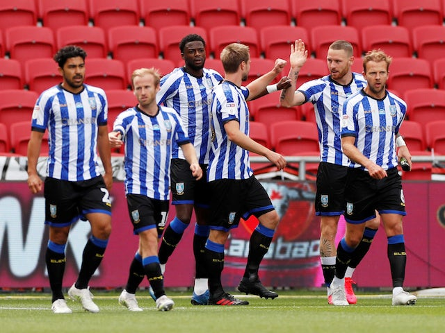 Sheffield Wednesday players celebrate scoring against Bristol City on June 28, 2020
