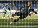 Leicester City's Kasper Schmeichel saves a penalty from Brighton & Hove Albion's Neal Maupay on June 23, 2020