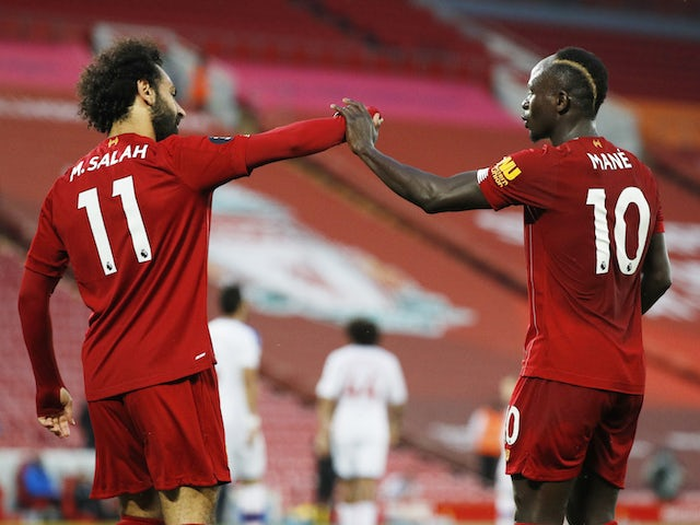 Liverpool's Sadio Mane and Mohamed Salah celebrate a goal against Crystal Palace on June 24, 2020