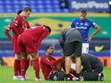 Liverpool defender Joel Matip receives medical attention during the derby against Everton on June 21, 2020