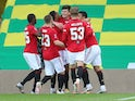 Manchester United defender Harry Maguire celebrates with teammates after scoring the winner against Norwich on June 27, 2020