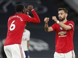 Manchester United pair Paul Pogba and Bruno Fernandes bump fists on June 19, 2020