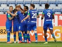 Wigan Athletic players celebrate scoring against Blackburn on June 27, 2020