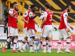 Arsenal players celebrate scoring against Wolves on July 4, 2020