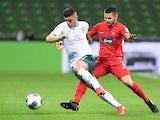Werder Bremen's Milot Rashica in action with Heidenheim's Marnon Busch on July 2, 2020