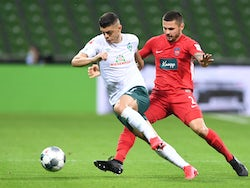 Werder Bremen's Milot Rashica in action with Heidenheim's Marnon Busch on July 2, 2020