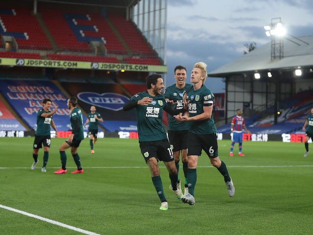 Burnley players celebrate Ben Mee's goal against Crystal Palace on June 29, 2020