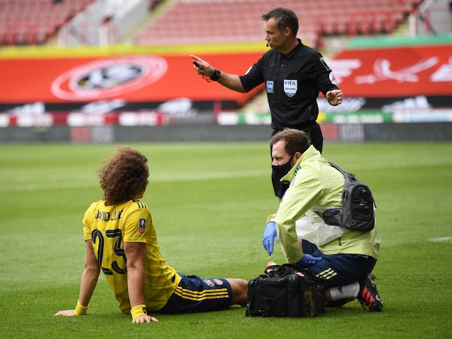 Arsenal defender David Luiz receives treatment for an injury on June 28, 2020
