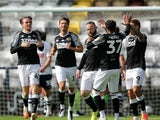 Derby County's players celebrate Wayne Rooney's freekick against Preston North End on July 1, 2020