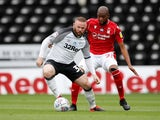 Derby County's Wayne Rooney in action with Nottingham Forest's Samba Sow on July 4, 2020