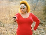 Drag legend Divine in her gun-toting pomp