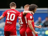 Fulham's Harry Arter celebrates with teammates after scoring against QPR on June 30, 2020