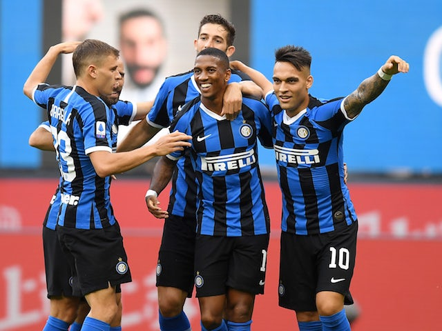 Inter Milan players celebrate with Ashley Young after he scored their opening goal in a win over Brescia