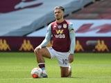 Aston Villa skipper Jack Grealish takes the knee on June 27, 2020