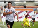 Sheffield United defender John Egan celebrates equalising against Burnley on July 5, 2020