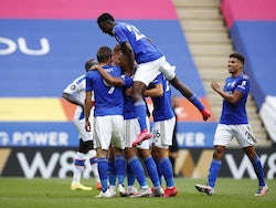 Leicester City players celebrate Jamie Vardy's 100th Premier League goal after scoring against Crystal Palace on July 4, 2020